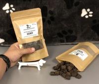 Natuurlijke beloning hond eend